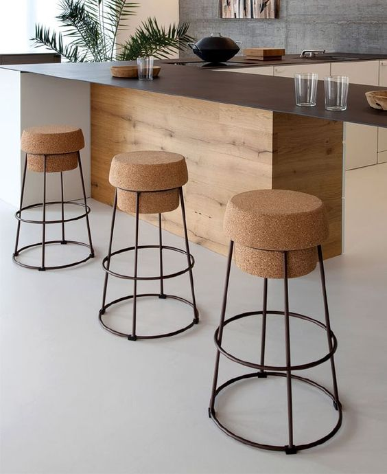 a cork seat that reminds of wine bottles and blak frames work perfect together