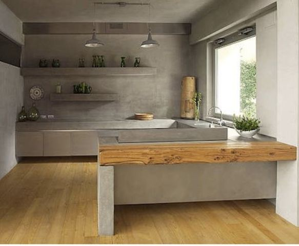 concrete walls and countertops echo and create a mood in this kitchen