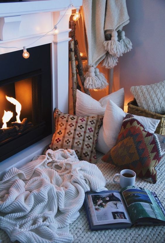 create your own nook by the fireplace just putting pillows and blankets there