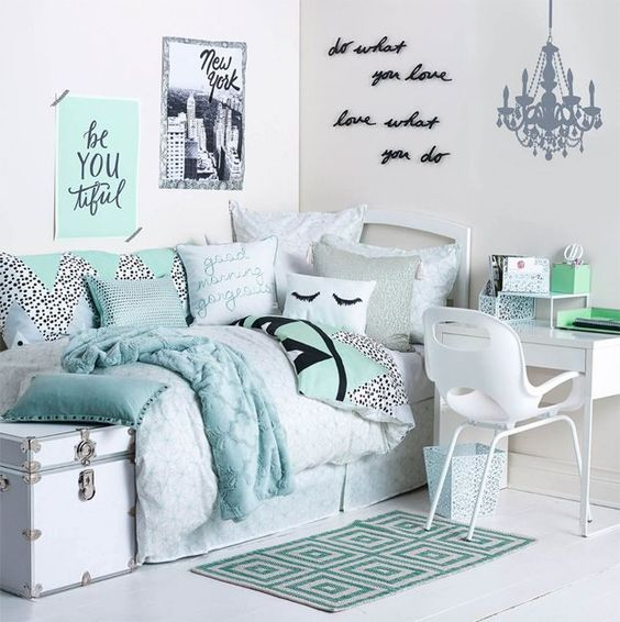 glam dorm room done in turquoise and aqua shades, with calligraphy