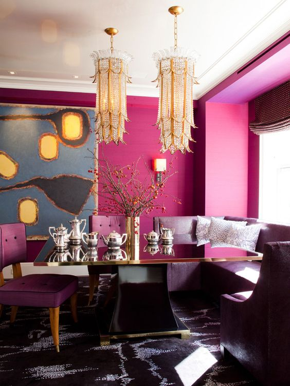 refined dining space with fuchsia walls, unique gold chandeliers and purple furniture