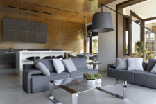 06 sofas here perfectly divide the space into zones and separate the living space from the kitchen