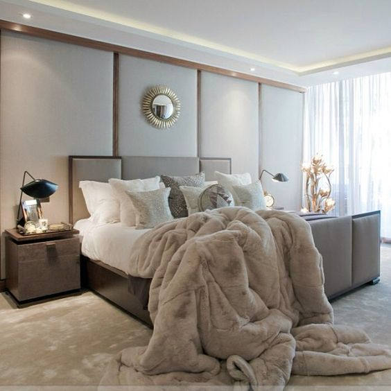 taupe bed floor and a faux fur blanket for a cozy modern bedroom look