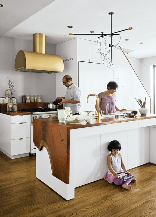 white kitchen island with a rough wood edge cover looks unusual