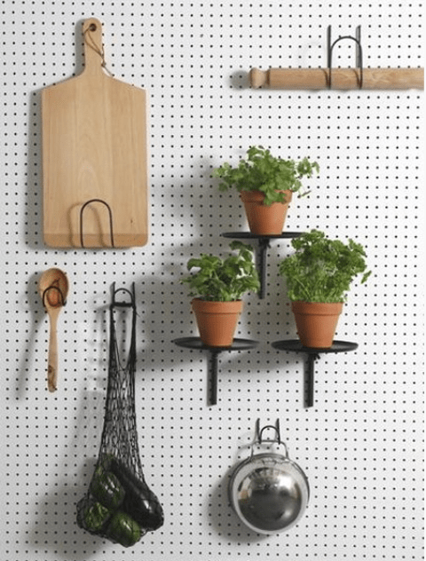 white pegboard with black shelves and hooks looks modern
