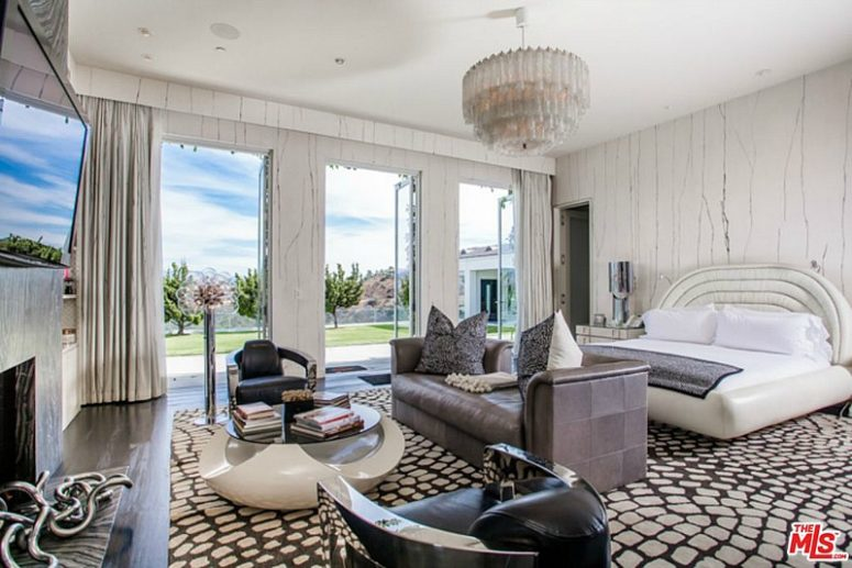 The master bedroom is done in white, neutrals and a bit of browns, looks luxurious