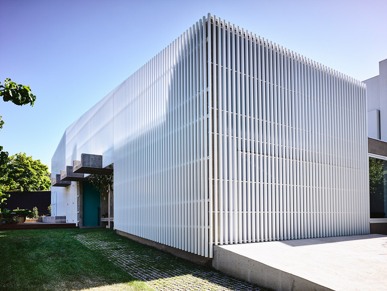 The white slats offer structural clarity and reference the architecture of the neighbourhood for visual cohesion