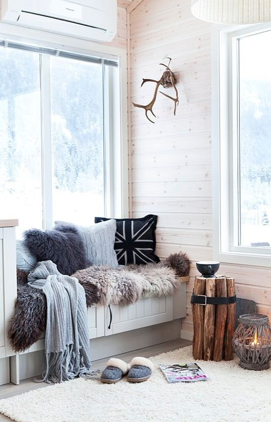 a window sill with a radiator hidden inside can be a perfect place to curl in