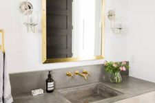 07 concrete sink and countertop look contrasting with gold touches