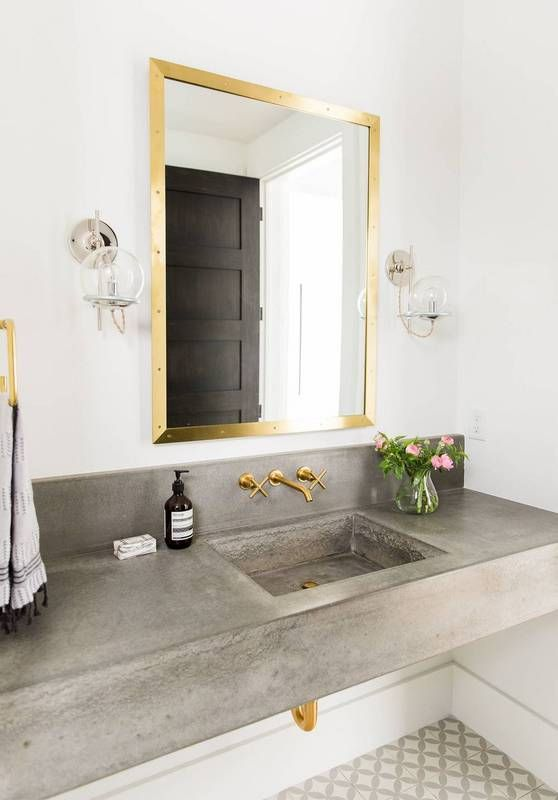 concrete sink and countertop look contrasting with gold touches