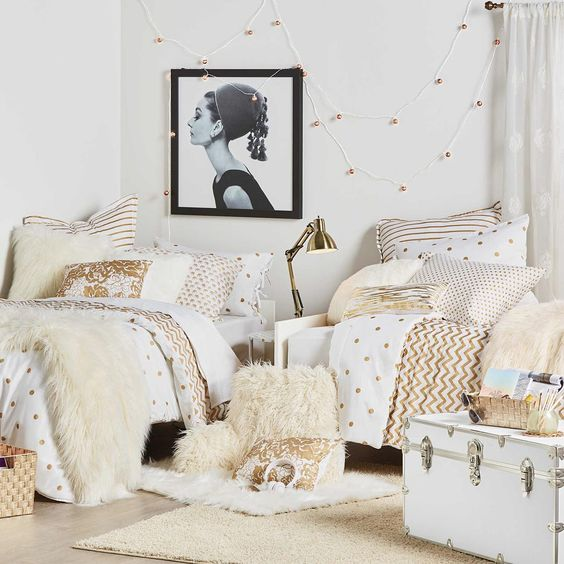 glam dorm room done with sophisticated metallics and enamel accents
