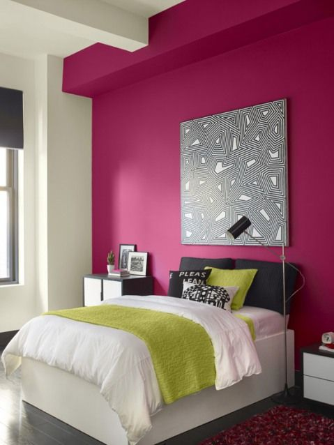 modern girlish bedroom with a fuchsia accent wall as a feminine feature