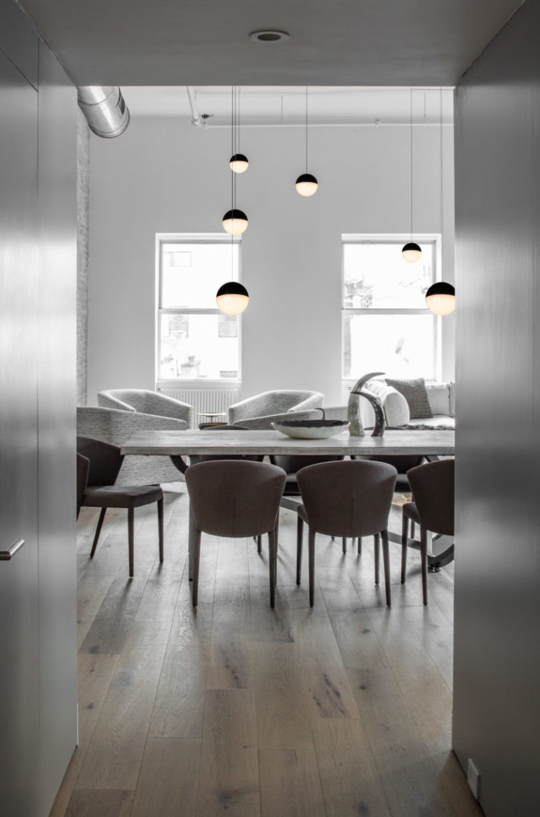 Exposed pipes kept the space industrial and sphere pendant lamps all over the space made it perfectly united