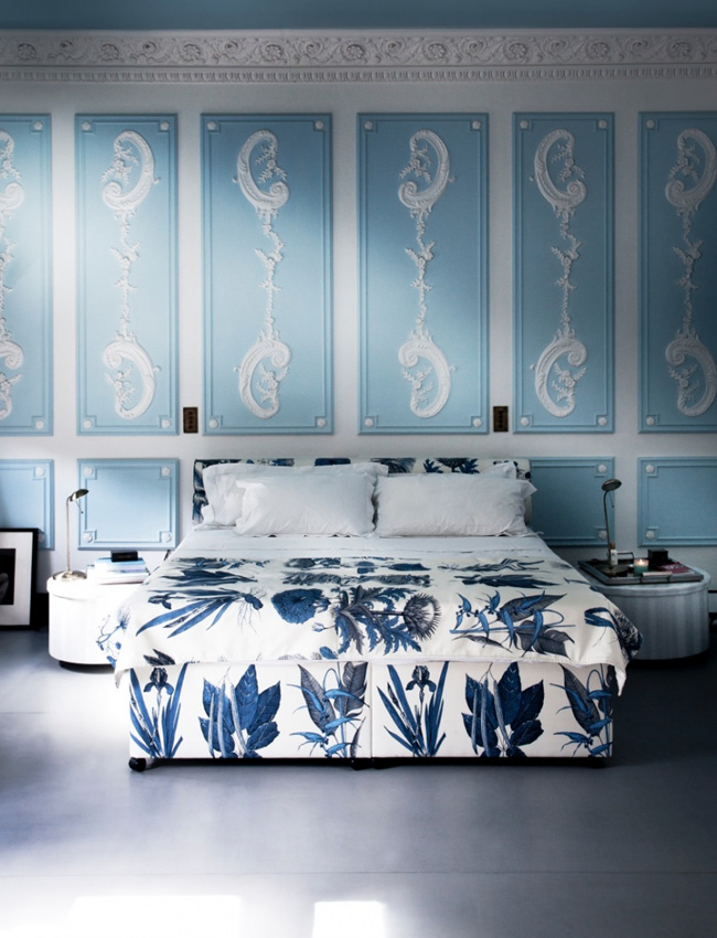 The bedroom strikes with an adorable shade of blue and white stucco on the walls