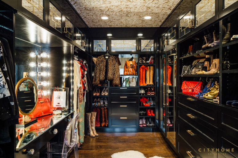 The closet is dark, and colorful clothes and accessories of the owners make it bolder