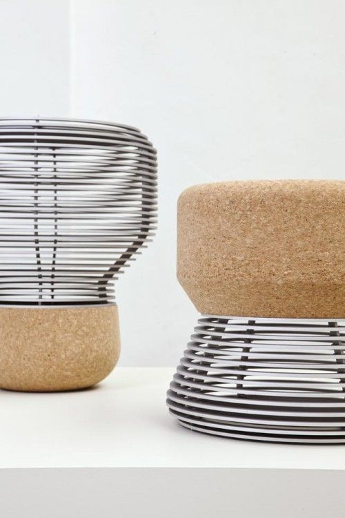 bulb-shaped stool with a cork seat and a framed base