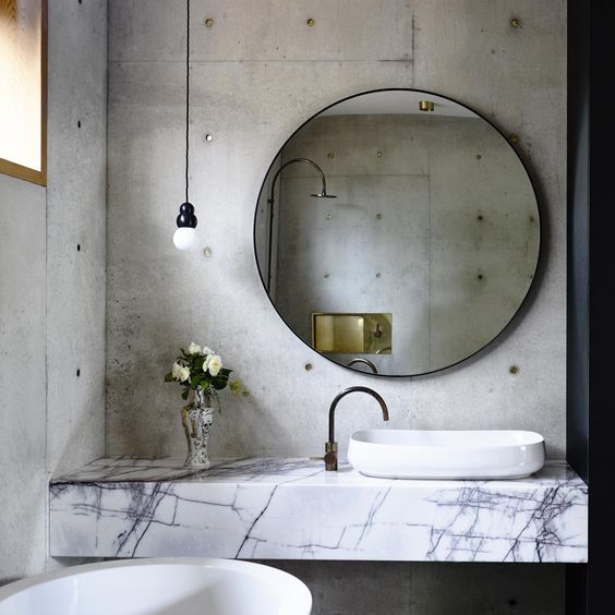 concrete walls and marble countertops look very unusual and cool together