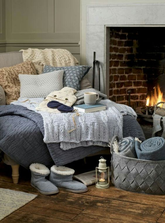 cozy daybed by the fireplace can be a perfect nook