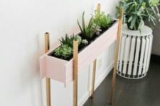 08 such a stylish blush planter on metallic legs can accentuate the room