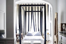 09 The bedroom is full of light, there's a large frame bed placed under an arched ceiling