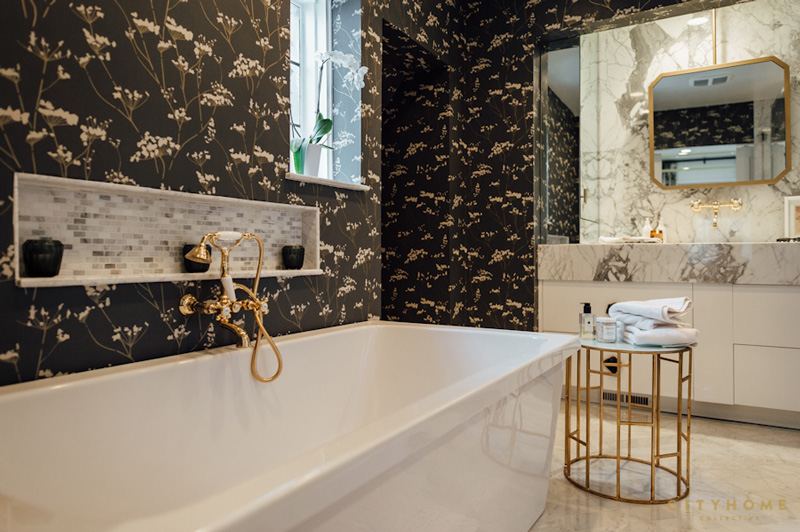 The master bathroom has a touch of mid century, with brass and copper details and marble