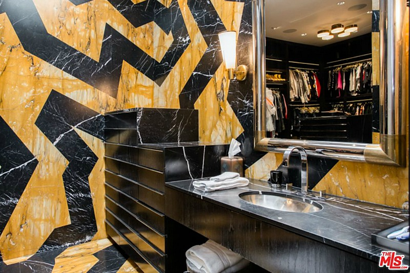 This futuristic bathroom is great with its yellow and black design and a marble tabletop