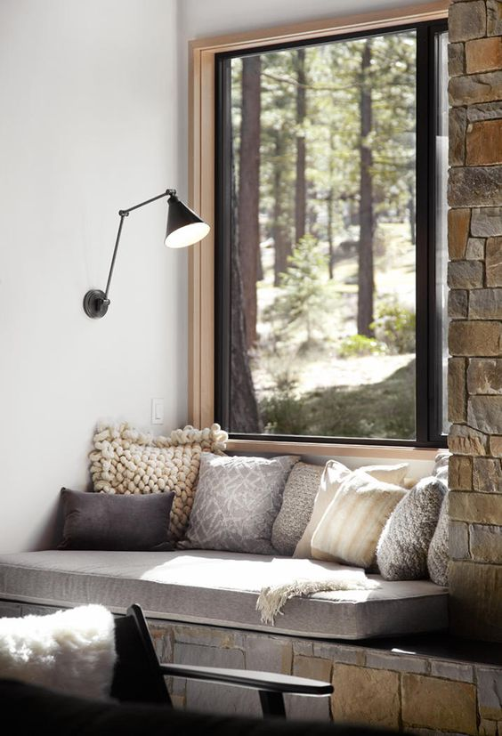 cozy window seat with pillows for reading there