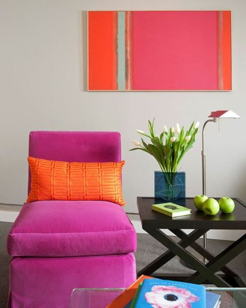 fuchsia lounge chair and an artwork that echoes with it