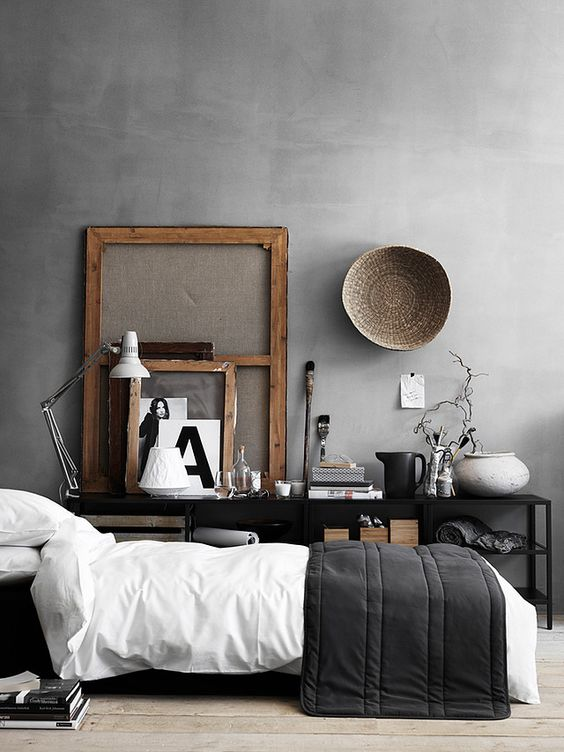 modern masculine bedroom with a concrete wall
