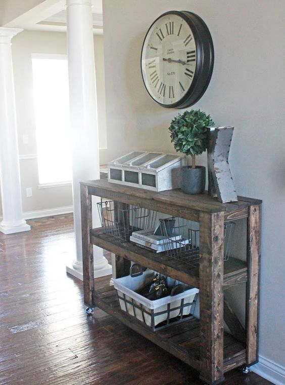 such three-tiered wooden console can be easily DIYed for your entryway