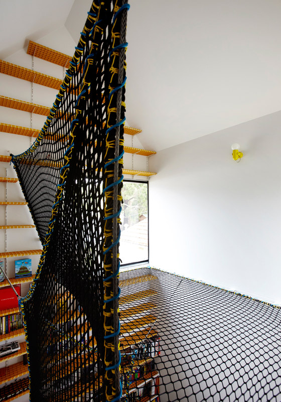 there are a lot of kids' zones in the house, including this one with steps and a net for fun