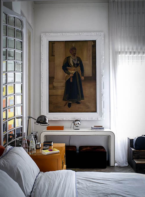 Modern glam furniture and antique artworks look amazing together creating an unusual space with its character