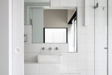 10 The bathroom is modern and chic, I love the geometry of mirrors here, they create a simple yet eye-catching accent