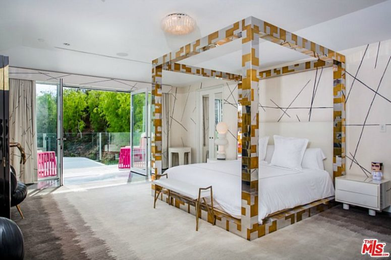The bed is a focal point in this bedroom, it's done in silver and gold geometric patterns