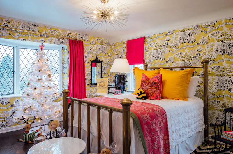 The kids' room is done in super bold colors like yellow and fuchsia