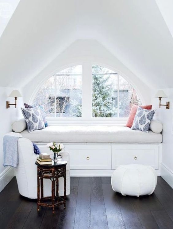 all-white window sill nook is a great place to spend time in the winter