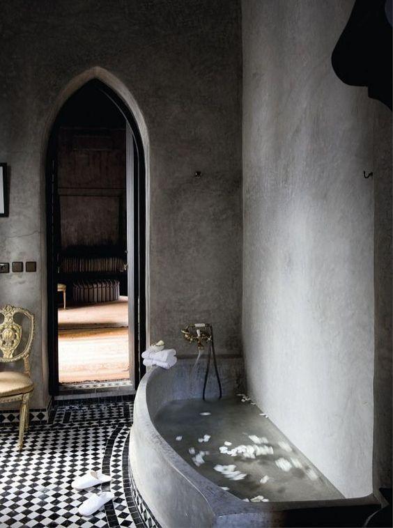 concrete bathtub in a Moroccan-styled bathroom