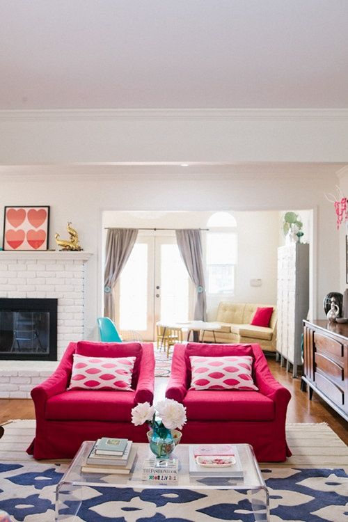 fuchsia chairs brighten up this light-colored living room