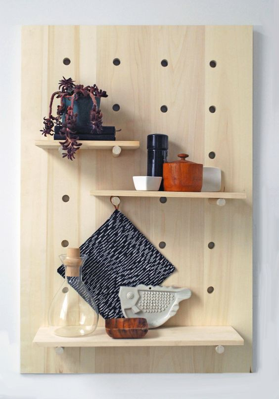 modern pegboard shelving system for storing spices