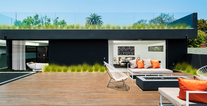 The terrace features a lot of grass, and so does the roof