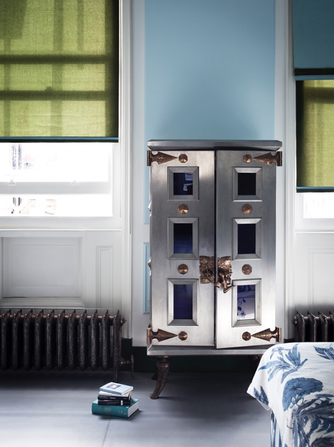 The wardrobe reminds of a safe, it's bold and whimsy