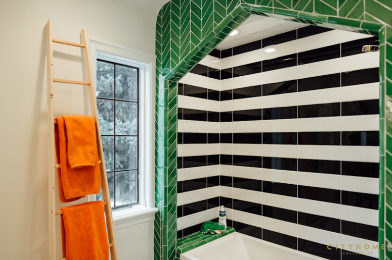 This is another bathroom with black and white and green tiles, so bold and cool
