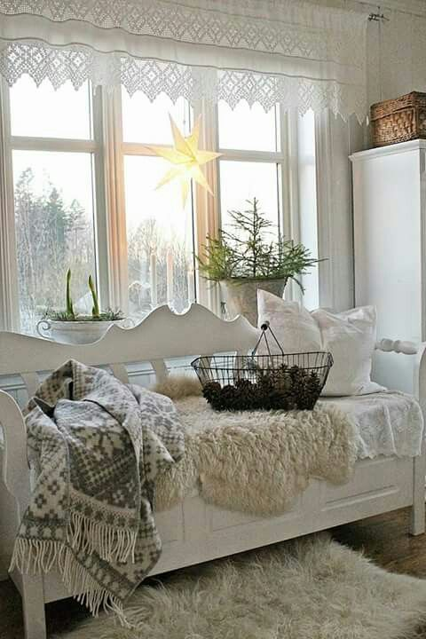 a bench placed by the window can become a great place to relax