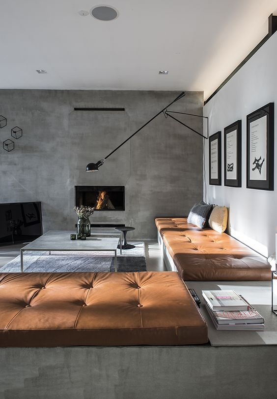 chic masculine living room with a concrete wall and copper leather