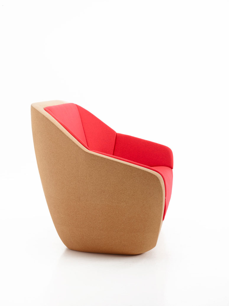 cork chair with hot red upholstery is a cool statement in a modern space