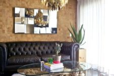 11 cork tile accent wall in the living room for a contrast with dark floors and a sofa