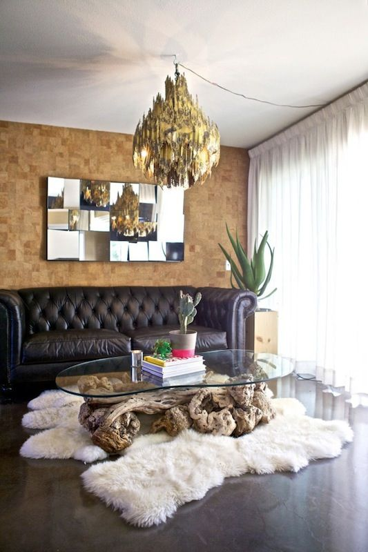 cork tile accent wall in the living room for a contrast with dark floors and a sofa