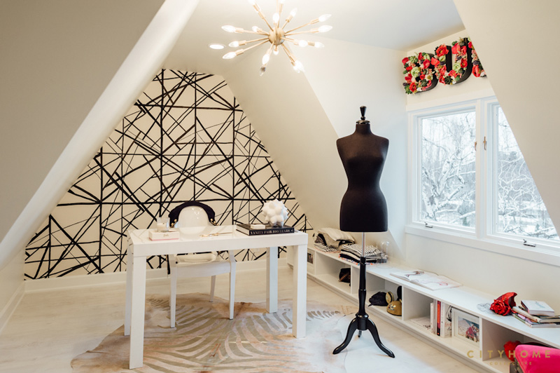 The owner's home office is decorated with a lot of feminine touches