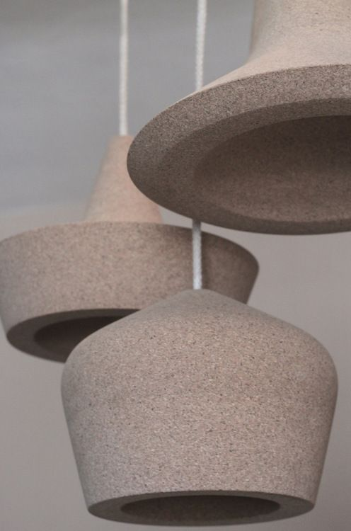 cork pendant lamps in different shapes look like a composition together