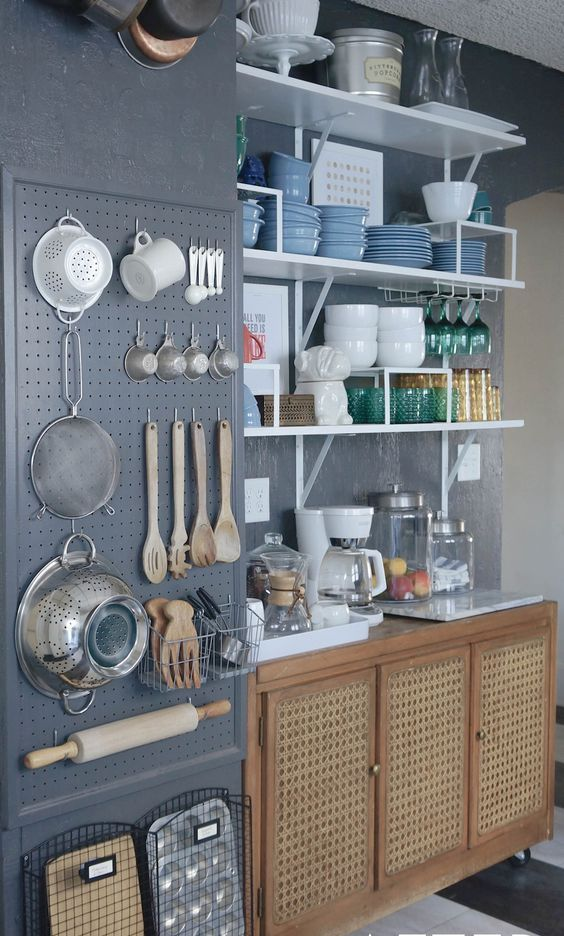 dark grey wall storage with utensils and cooking stuff